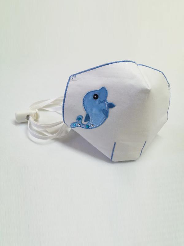 Mascarilla infantil higiénica re-utilizable , con transfer con diseño de delfin